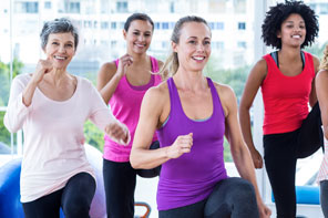 Group of women doing cardio exercise