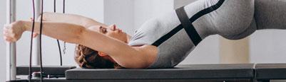 Woman on Pilates Reformer