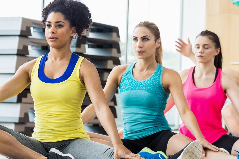 Group of women doing Vinyasa Yoga