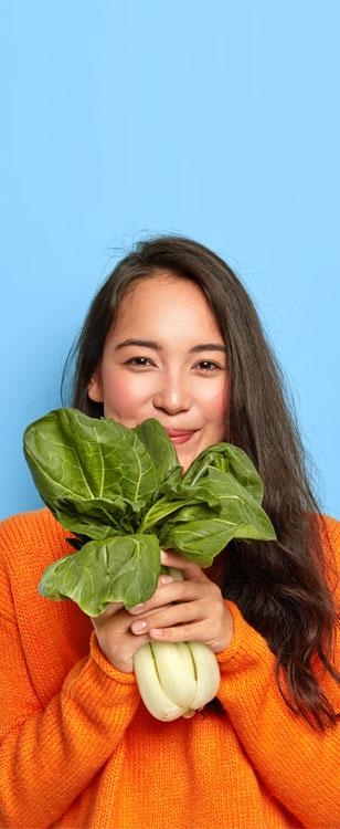 Woman holding veg