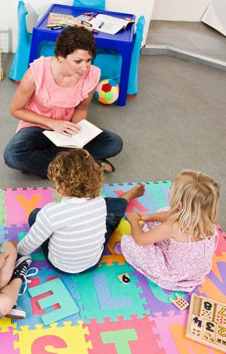 Child care provider reading to children